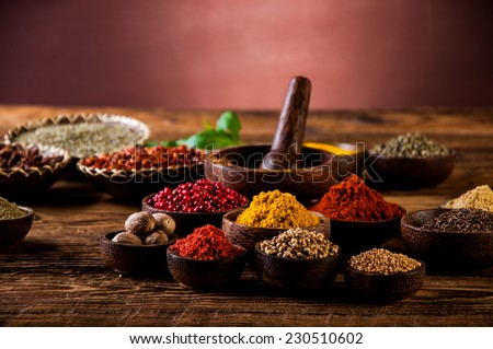 Hot spices in wooden bowls - stock photo