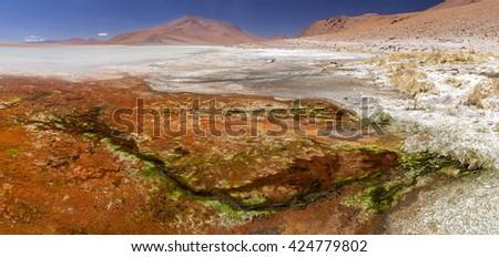 hot spring and salt lake on altiplano, Bolivia - stock photo