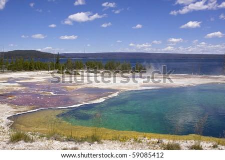 Hot spring at Yellowstone lake - stock photo