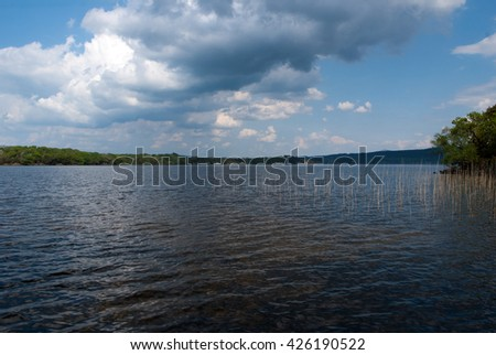 Hot spring day over the calm lake in the Killarney National Park in County Kerry in Ireland, May - stock photo
