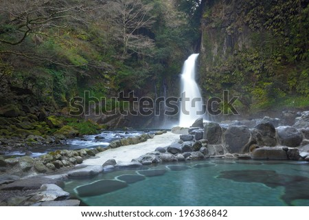 hot spring pool with view of waterfall - stock photo