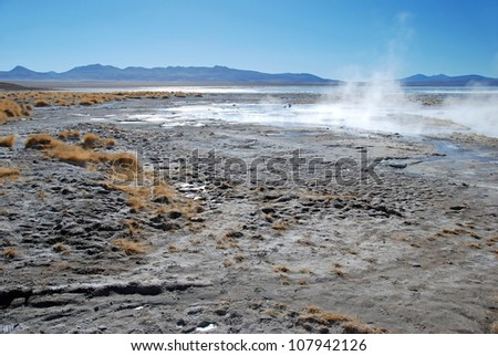 hot springs in the bolivian desert with a blue clear sky - stock photo