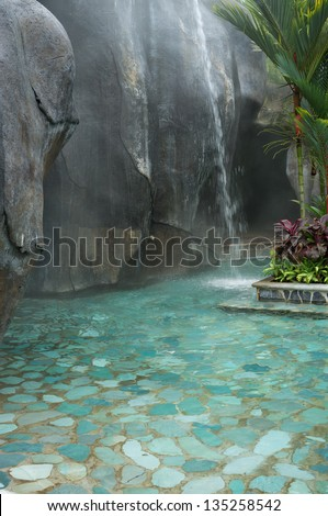 Hot springs waterfall in a thermal spa - stock photo