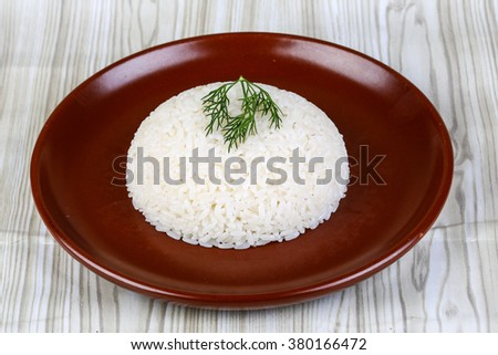 Hot Steamed rice with dill branch on the brown plate