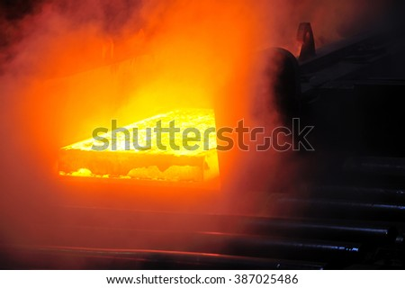 hot steel plate on conveyor in steel mill