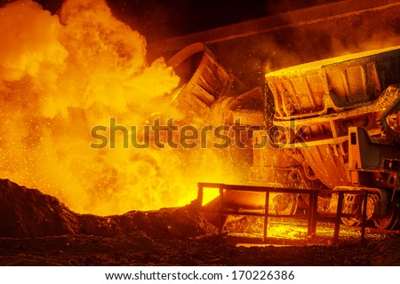 Hot steel pouring in steel plant - stock photo