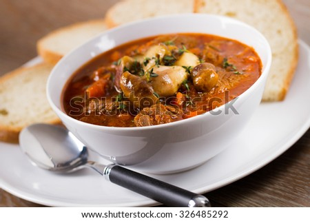 Hot stew with mushrooms - stock photo