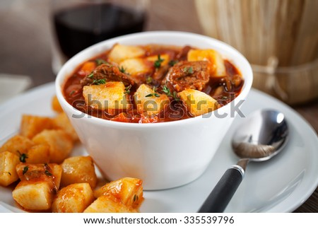 Hot stew with potatoes - stock photo