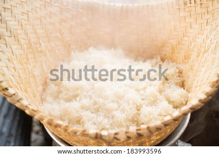 Hot sticky rice and wooden steamer