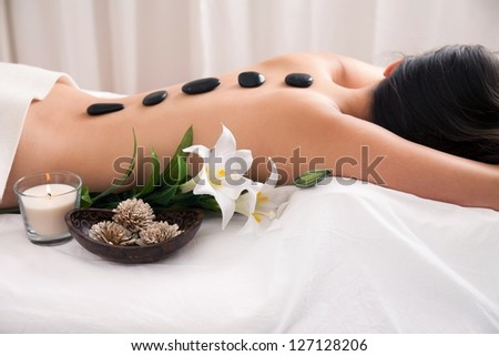 Hot Stone wellness treatment with decoration - stock photo