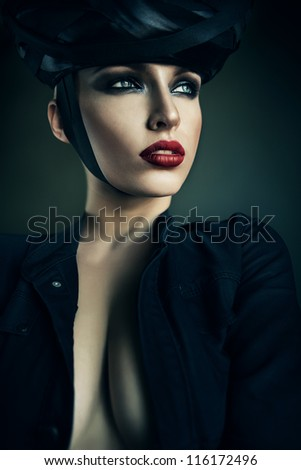 Hot strict woman in black hat - stock photo