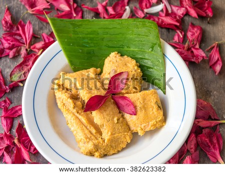 Hot tamales, decorated with with a banana leaf under. Traditional Cuban tamale filled with pork and other types of spices and condiments. like Onions and garlic. - stock photo
