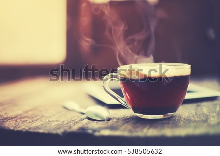 Hot tea cup on a frosty winter day window background