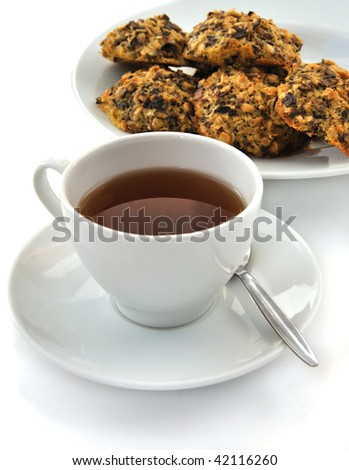 Hot tea cup with fresh cookie - stock photo
