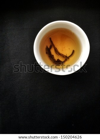 Hot tea on the black background - Chinese style. - stock photo
