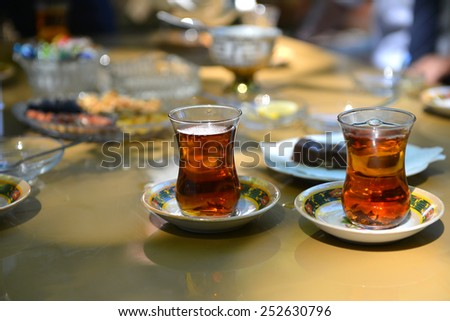 Hot tea served in Azerbaijan typical cup - stock photo