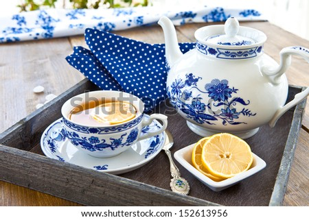 Hot tea with a slice of fresh lemon - stock photo