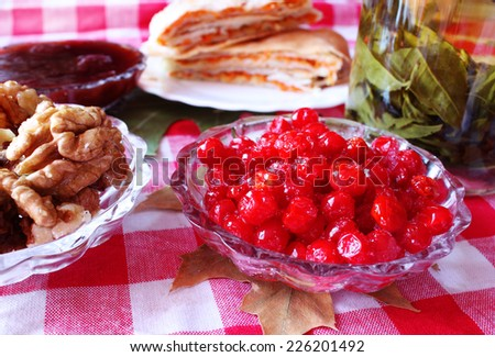 Hot tea with jam viburnum and nuts - stock photo