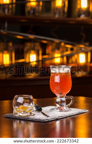 Hot toddy cocktail on the bar - stock photo