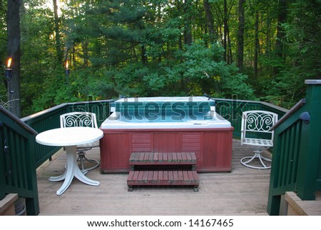 Hot tub on deck - stock photo