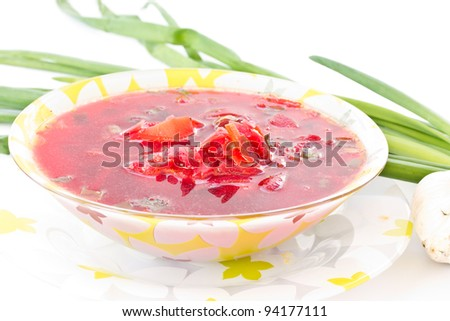 hot Ukrainian red borsch is in a dish