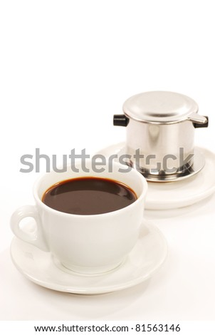 hot Vietnamese coffee cup and filter - stock photo