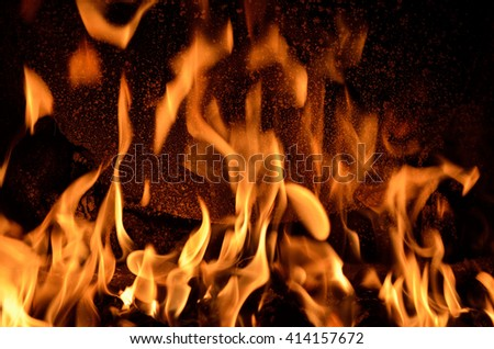 Hot vivid burning birch logs in fireplace on a cold winter day - stock photo