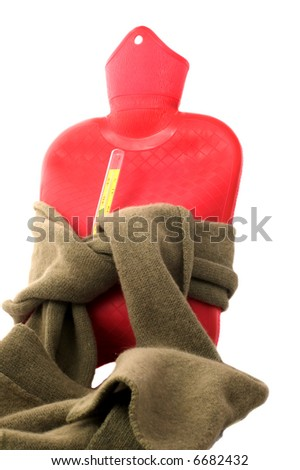 Hot-water bottle with scarf and thermometer isolated on white