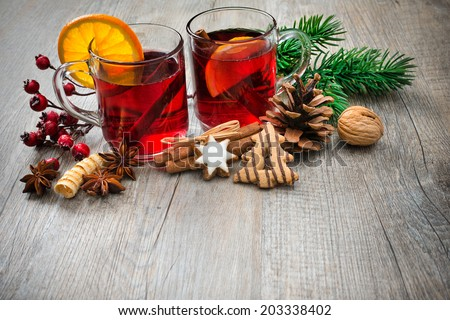 Hot wine for winter and Christmas with orange and spices - stock photo