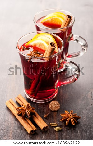 Hot wine (mulled wine) with spices - stock photo