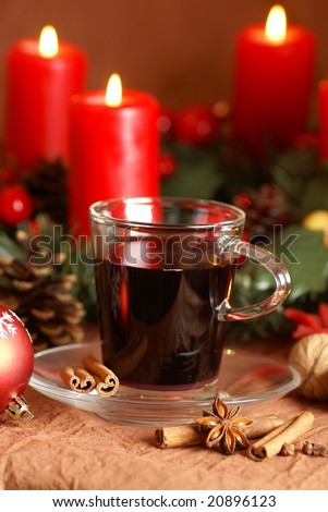 Hot wine, spices and christmas decorations