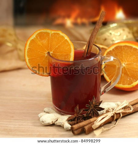 hot winter tea  and background with fireplace - stock photo