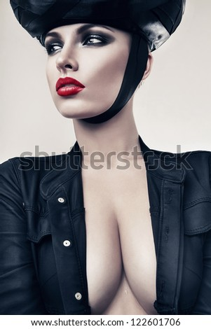 hot woman in jacket and black hat - stock photo