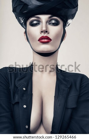 hot woman in jacket and hat - stock photo