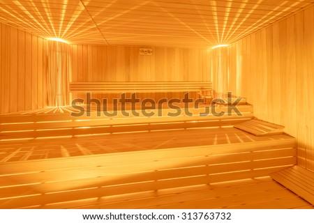 Hot wooden sauna room interior - stock photo