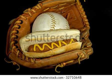 hotdog and softball in glove - stock photo