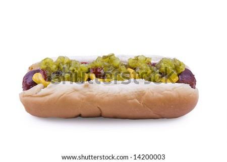 Hotdog one a bun with ketchup, mustard, and relish.  Isolated on white. - stock photo