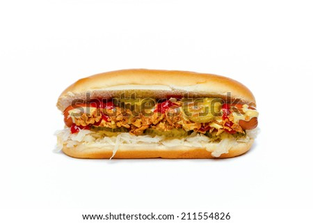 Hotdog with Sauerkraut, Cucumber, Ketchup, Mustard and roasted Onions displayed from the side. Isolated on white. - stock photo