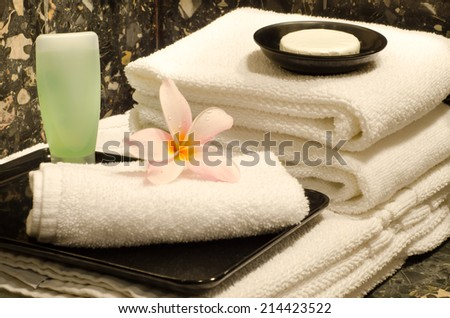 Hotel Amenities (Towels,shower bath and soap) with frangipani : Actual photography in hotel environment  - stock photo