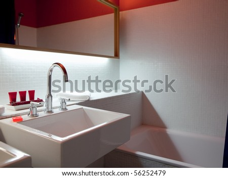 Hotel bathroom. No visible logos, brand names, or trademarks. - stock photo