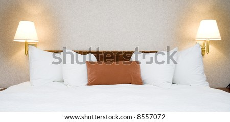 Hotel bed - stock photo