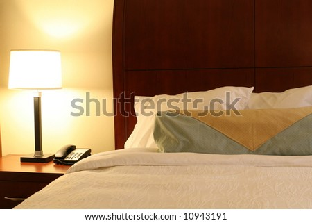 Hotel Bed & Night Table - stock photo