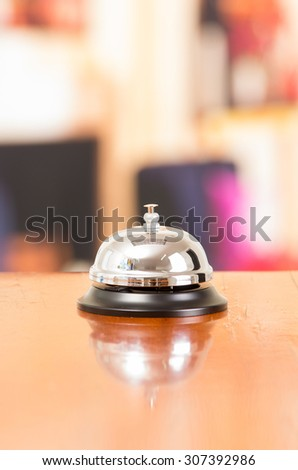 hotel bell in reception desk close up selective focus - stock photo