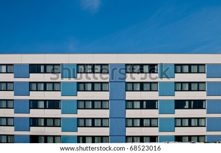 Hotel building with blue concrete walls