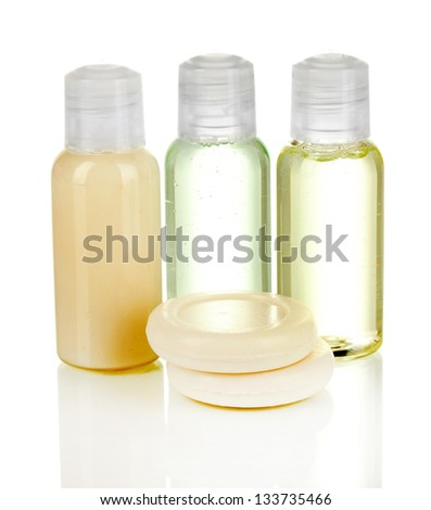 Hotel cosmetic bottles with soap isolated on white - stock photo