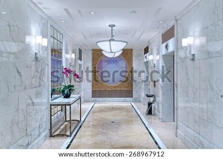 hotel decorated corridor with elevator - stock photo