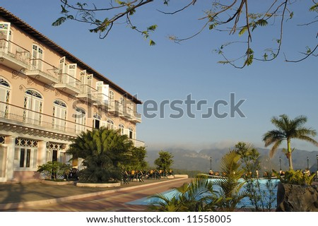 Hotel in Cuba. This hotel with swimming pool is situated in the Valle de Vinales. This is an UNESCO World Heritage site - stock photo