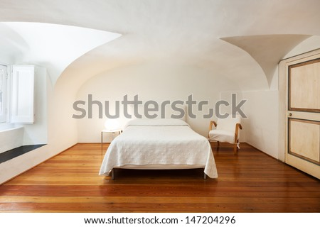 hotel in historic palace, interior, view bedroom  - stock photo