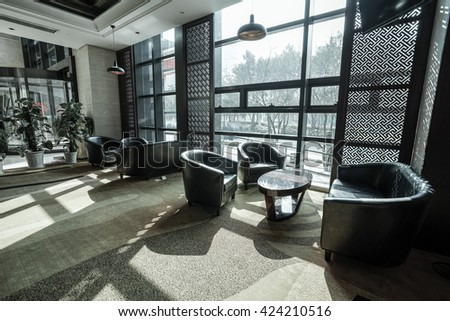 Hotel lobby interior.With crystal lamp,bing hall, marble floor, french sash,mosaic tile,comfortable sofa, etc. - stock photo