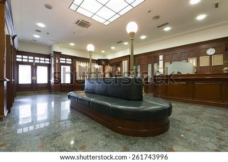 Hotel lobby with reception  - stock photo